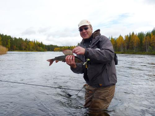 en vacker harr i lycka och vemod på fisketidningen