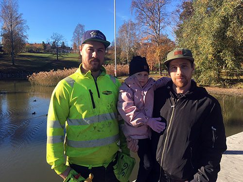 Carp rescuers Jimmy Persson, and Patric Larsson, in the middle Patric's daughter Ellie.
